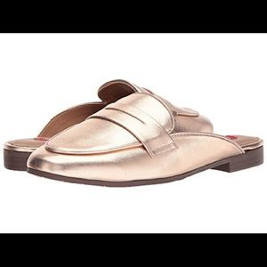 Rose gold loafer style slip-on flat.